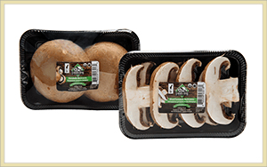 whole and sliced organic portabello mushrooms with Farmers' Fresh label